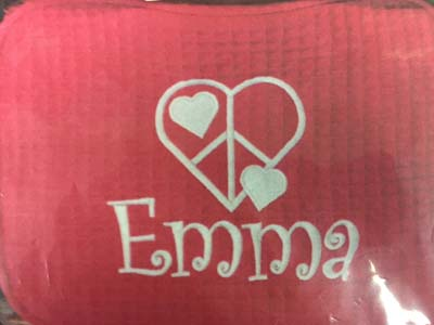 Emma's hot pink waffle case with heart/peace design as pictured