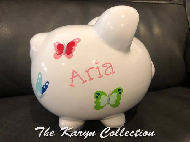 Aria's custom butterfly piggy bank