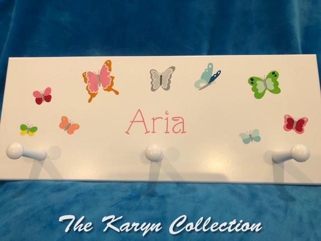 Aria's custom butterfly wall coatrack