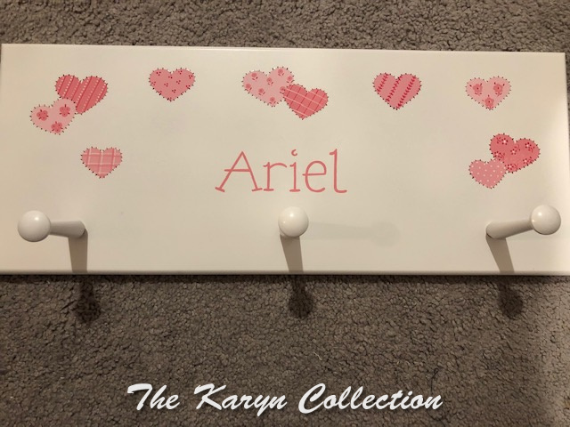 Ariel's patchwork hearts coatrack in shades of pinks