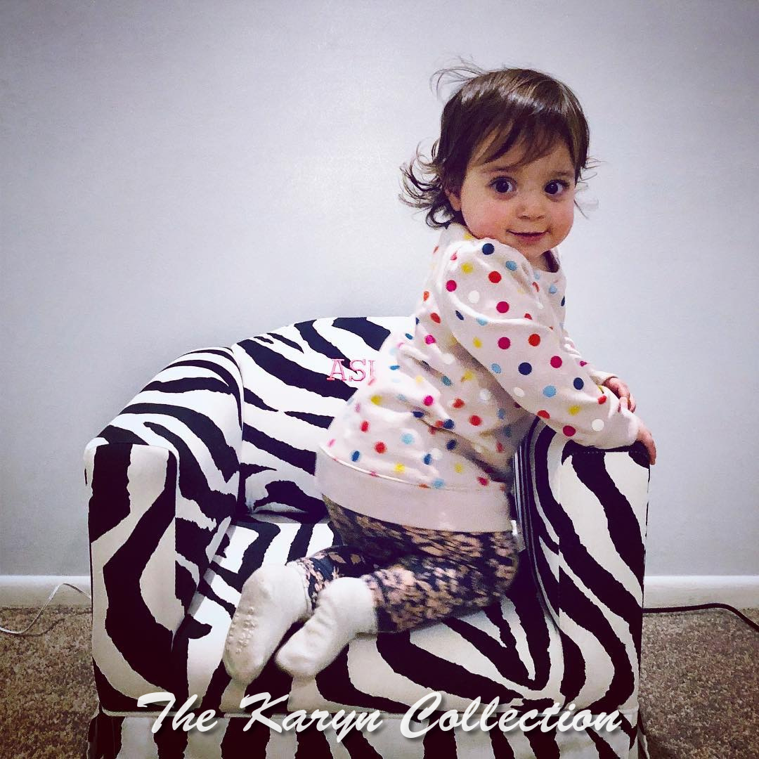 Ashley's zebra print chair with ruffled bottom