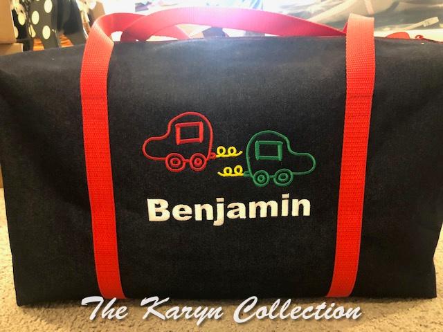 Benjamin's denim duffle with primary cars