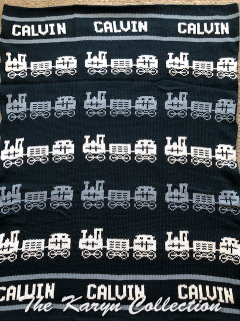*EXCLUSIVELY OURS - Calvin's Navy train blanket in denim and white