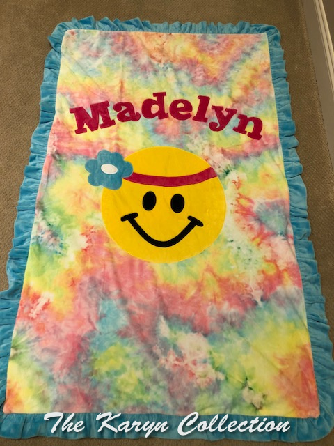 Madelyn's pastel tie dye happy face blanket in toddler size