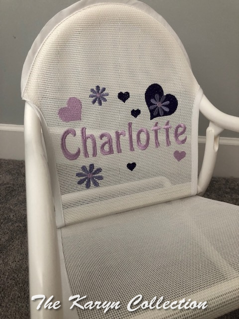 Charlotte's Purple Hearts and daisies on White Rocker