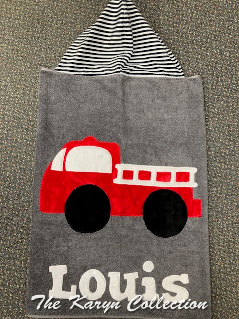 Louis 's firetruck towel on dark gray