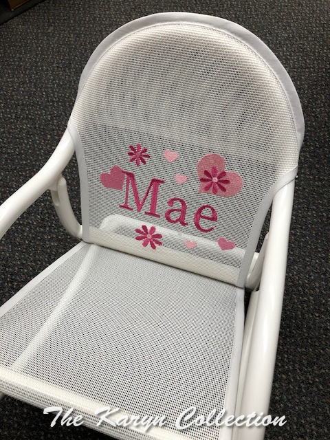 Mae's Hearts and Daisies Rocker in shades of pink