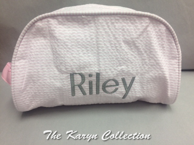 Riley's pink seersucker Dopp kit