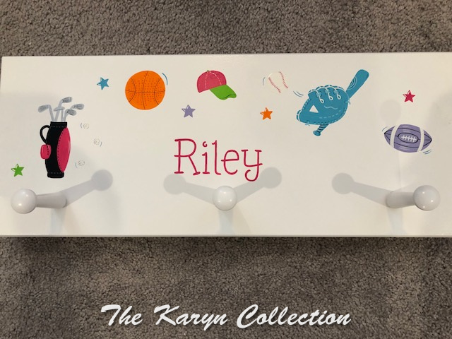 Riley's all sports wall coatrack in girl colors..... )