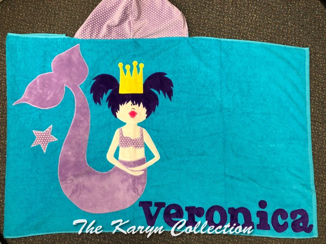 Veronica's mermaid toddler towel on turquoise