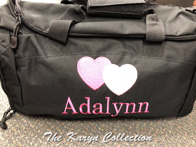 Adalynn's solid black Duffle Bag with Hearts