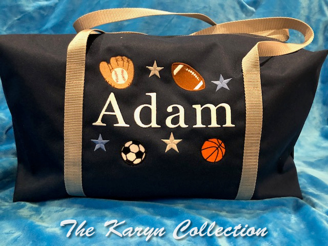 Adam's suitcase in navy bag trimmed in silver/gray