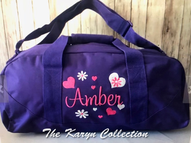 Amber's purple duffle with hearts and daisy in hot pink and white