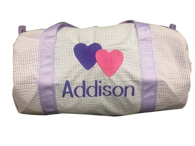 Addison's lavender seersucker duffle bag with 2 hearts