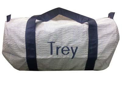 Trey's navy seersucker duffle bag