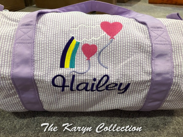 Hailey's lavender duffle with valentine rainbow design
