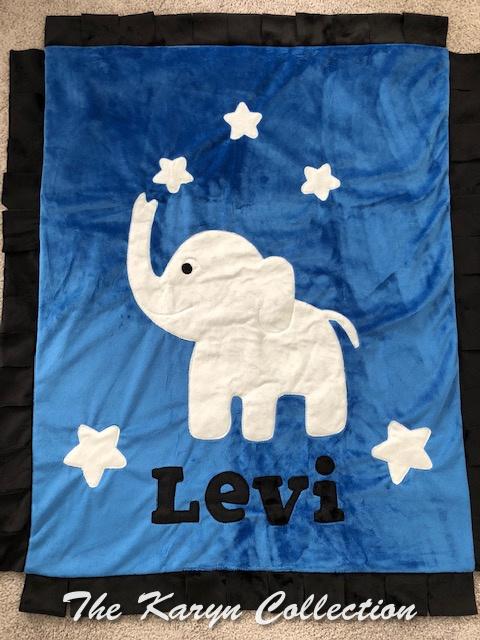 Levi's White Elephant on Blue Blanket