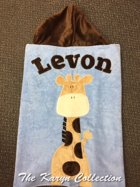 Levon's Giraffe Toddler Towel on light blue