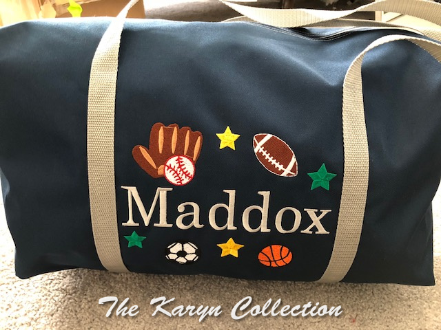 Maddox's suitcase in navy bag trimmed in silver/gray