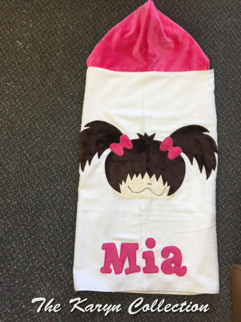 Mia's little girl face with pigtails on a toddler towel