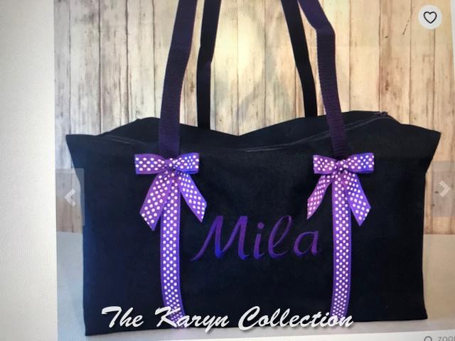 Mila's denim duffle with purple name and purple polka dot ribbons