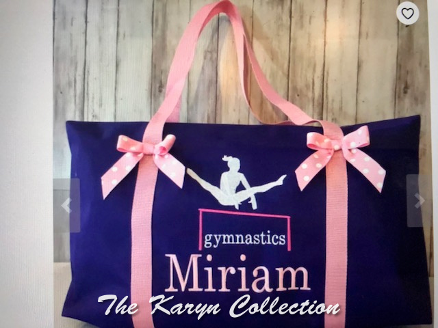 Miriam's purple gymnastics bag with pink trim