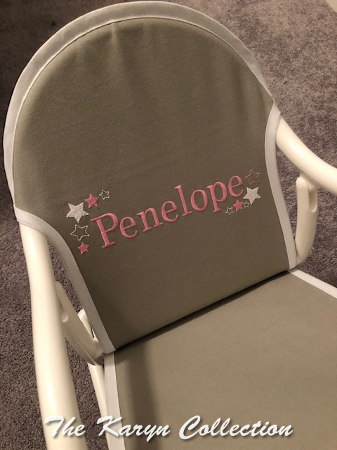 Penelope's gray rocker with stars in white and medium pink
