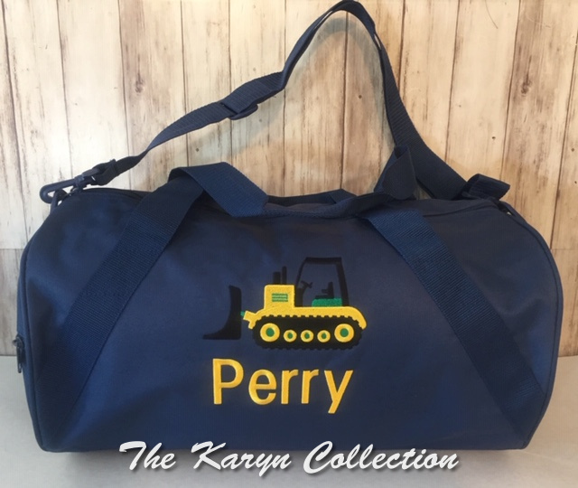 Perry's navy bag with construction truck