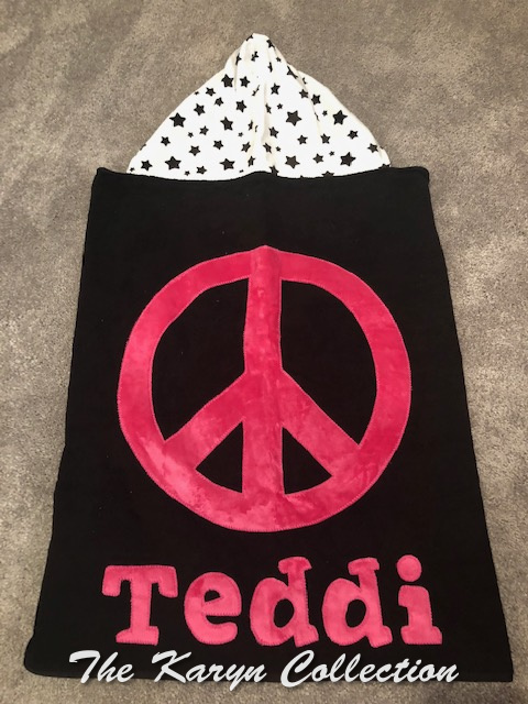Teddi's black towel with hot pink peace sign and stars hood